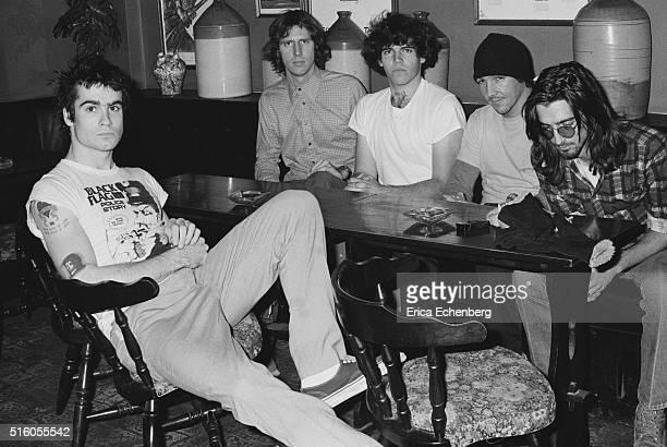 Hardcore punk band Black Flag group portrait at the Oporto pub Holborn London United Kingdom 1983 LR Henry Rollins Greg Ginn Bill Stevenson Chuck...