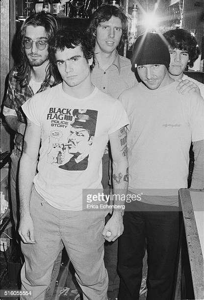 Hardcore punk band Black Flag group portrait at the Oporto pub Holborn London United Kingdom 1983 LR Dez Cadena Henry Rollins Greg Ginn Chuck...