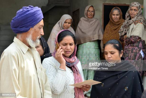 Hardeep Singh with their daughter Gurpinder Kaur grieving the death of his son Manjinder Singh and Sukhdeep Kaur sister of Harsimranjit Singh one of...