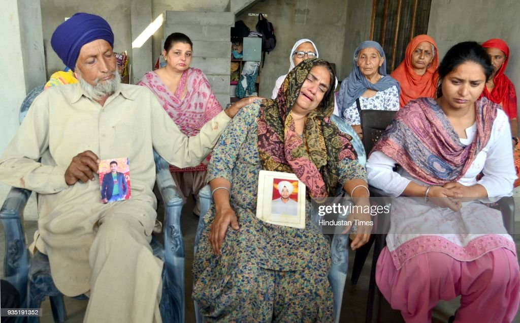 Hardeep Singh with his wife Sukhwinder Kaur and Gurpinder Kaur daughter grieving the death of her son Manjinder Singh who was killed in Iraq at...