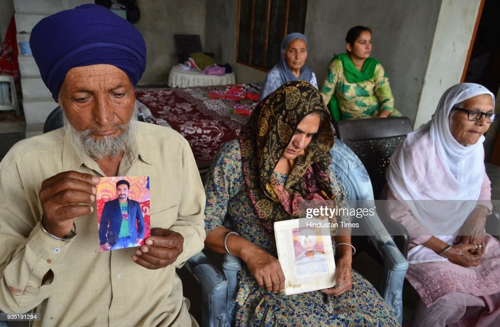 Hardeep Singh with his wife Sukhwinder Kaur grieving the death of her son Manjinder Singh who was killed in Iraq at Bhoewal Village on March 20 2018..