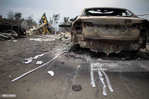 Hardened drips of melted aluminum extend from a car in the ruins of structures burned by the Valley Fire on September 14 2015 in Middletown...