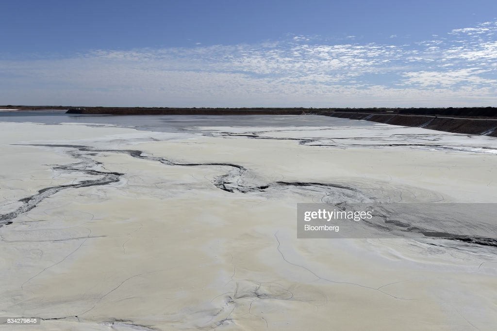 Hardened waste forms cracks and patterns on the surface of the tailings dam at Evolution Mining Ltd.'s gold operations in Mungari, Australia, on Tuesday, Aug. 8, 2017. Evolution Mining is Australias second-largest gold producer. Photographer: Carla Gottgens/Bloomberg via Getty Images