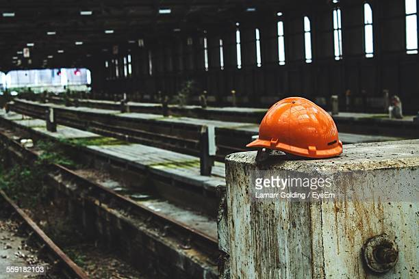 Hardhat On Ledge In Abandoned Factory