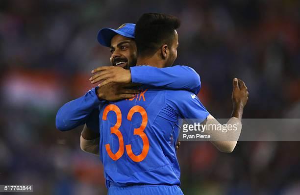 Hardik Pandya and Virat Kohli of India celebrates after Pandya took the wicket of Aaron Finch of Australia during the ICC WT20 India Group 2 match...