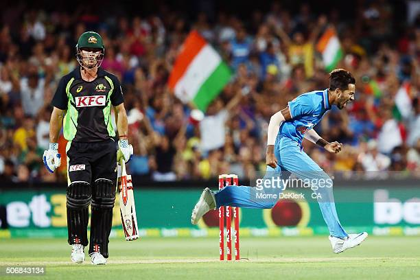 Hardik Pandya of India celebrates after taking the wicket of Chris Lynn of Australia during game one of the Twenty20 International match between...
