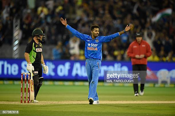 Hardik Pandya of India celebrates after taking the wicket of Chris Lynn of Australia during the second Twenty20 international cricket match between...