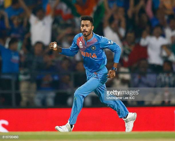 Hardik Pandya of India celebrates catching out Colin Munro of New Zealand during the ICC World Twenty20 India 2016 Group 2 match between New Zealand...
