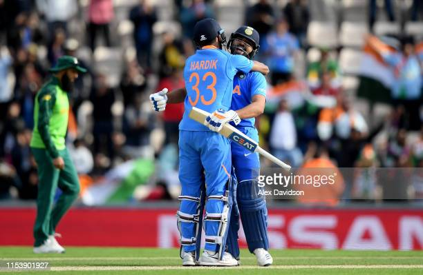 Hardik Pandya of India celebrates victory with Rohit Sharma of India during the Group Stage match of the ICC Cricket World Cup 2019 between South...