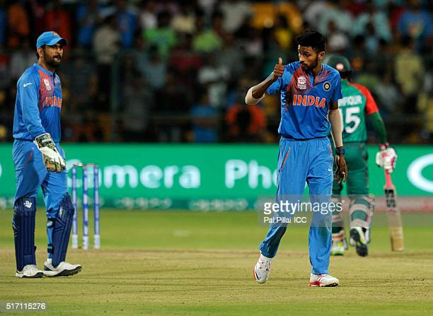 Hardik Pandya of India give a thumbs up to his captain M S Dhoni of India as he walks back to bowl the last over during the ICC World Twenty20 India...