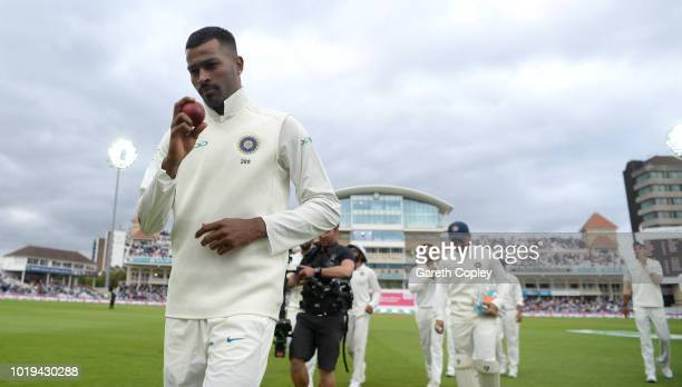 Hardik Pandya of India holds up the ball as his leaves the field after taking a five wicket haul during day two of the Specsavers 3rd Test match...