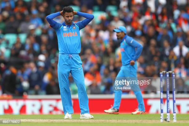 Hardik Pandya of India reacts after a dropped catch off his bowling during the ICC Champions trophy cricket match between India and Sri Lanka at The...