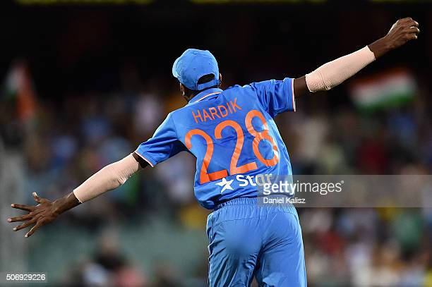Hardik Pandya of India reacts after taking a catch to dismiss Cameron Boyce of Australia and to win the game for India during game one of the...