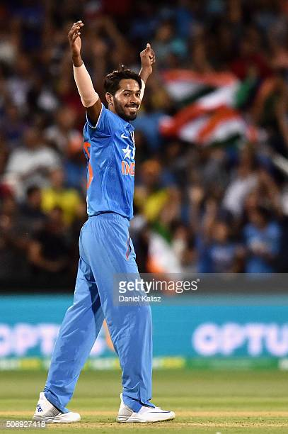 Hardik Pandya of India reacts after taking the wicket of Matthew Wade of Australia during game one of the Twenty20 International match between...