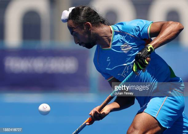Hardik Singh of Team India moves the ball past Niklas Wellen of Team Germany during the Men's Bronze medal match between Germany and India on day...