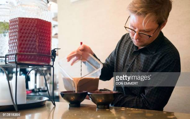 Harding Stowe pours Kava into a bowl to be served at Brooklyn Kava January 18 2018 in New York It's been a mainstay in the South Pacific for...