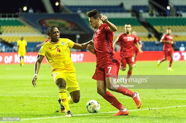 Hardlife Daniel Zvirekwi of Zimbabwe and Youssef Msakni of Tunisia battle during the African Nations Cup match between Zimbabwe and Tunisia on...