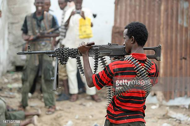A Hardline Islamist fighter aims a heavy machine gun towards government forces in Mogadishu on July 3 2009 The fighting broke out in the south...
