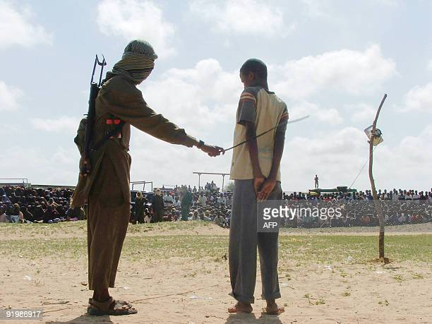 A hardline Islamist fighter flogs a teenager accused of rape in northern Mogadishu�s Suqaholaha neighborhood The Shebab group also ordered two men to...