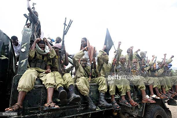 Hardline Islamist fighters from AlShabab chant slogans as they rally in the streets of Mogadishu on October 30 2009 to show their support for...