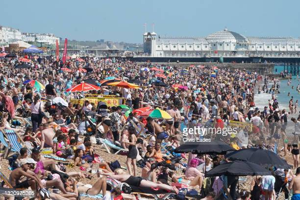 Hardly an inch to spare on Brighton beach as thousands flock to the seaside to make the best of the Bank Holiday sunshine and celebrate the easing of...