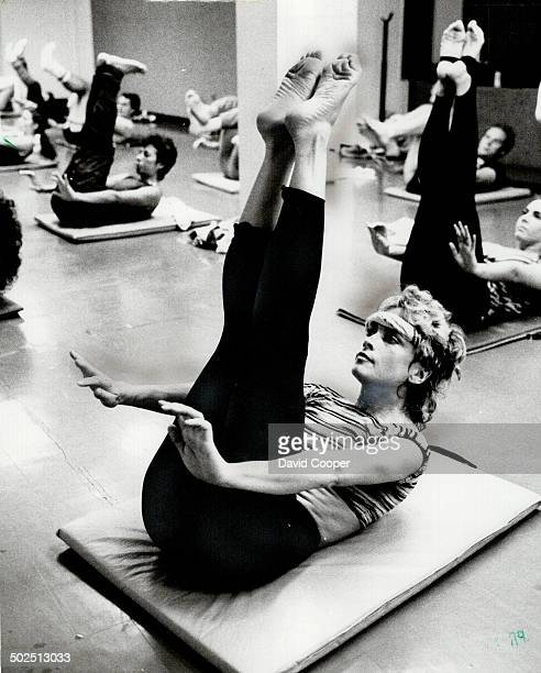 Hardmuscled Ann Margaret Rohmer leads a workout class at a down town club above 10 or 12 times a week Left Rohmer relaxes over a script in her...