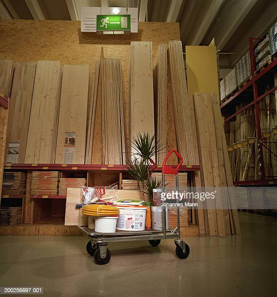 hardware goods on trolley by planks of wood - construction material stock pictures, royalty-free photos & images