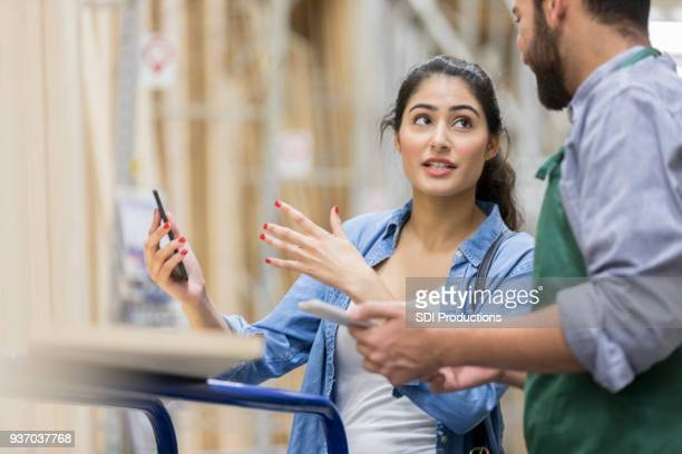 Hardware store customer explains idea to sales associate