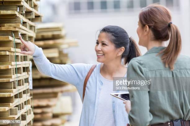 Hardware store employee assists customer