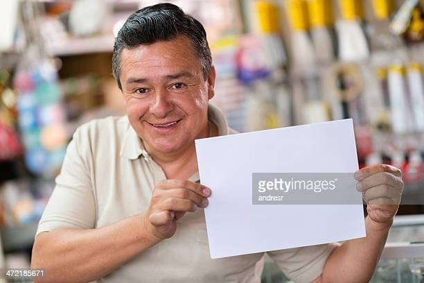 Hardware store worker with banner