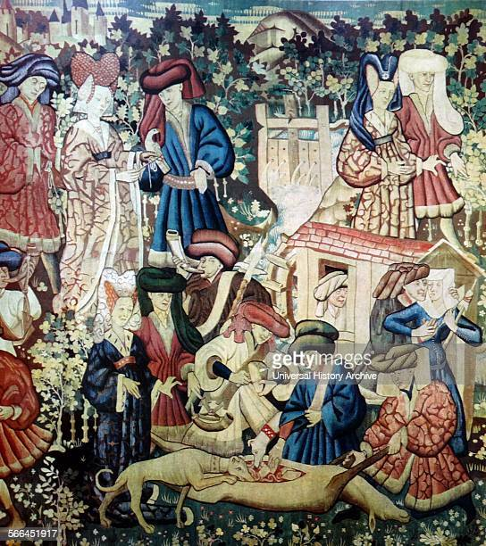 Hardwick tapestry depicting a mediaeval hunting scene The hunt has concluded in the tapestry the hind's stomach has been opened and the hounds are...