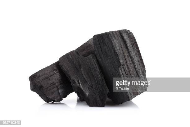 hardwood charcoal coal isolated on white background - ash stock pictures, royalty-free photos & images