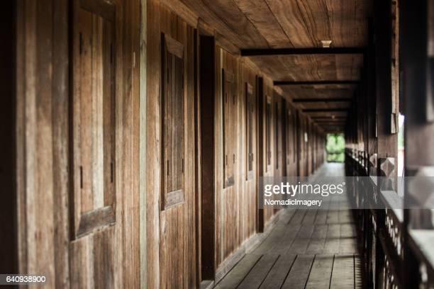 hardwood longhouse veranda vanishing point - longhouse stock photos and pictures