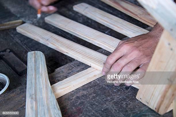 Hardworking carpenter Blue collar Cuban carpenter working on a wooden rocking chair