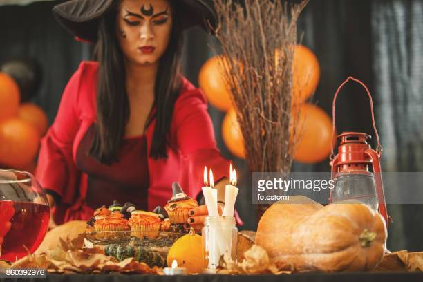 hardworking hostess - halloween party stock photos and pictures