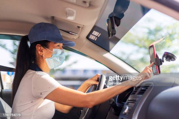 hardworking woman driving car for rideshare - driver stock pictures, royalty-free photos & images