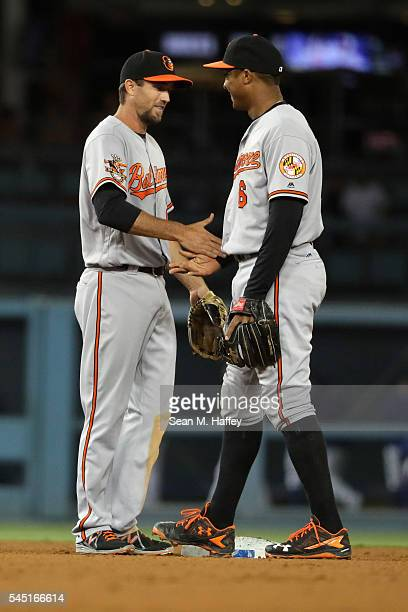 J Hardy and Jonathan Schoop of the Baltimore Orioles shake hands after defeating the Los Angeles Dodgers in a baseball game at Dodger Stadium on July...