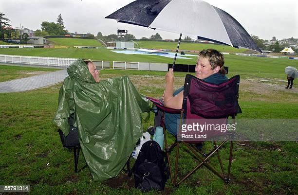 Hardy cricket fans Charmain Kirk and Sharon Woods both from Hawera in Taranaki wait for play to start in the rain delayed second day of the third...