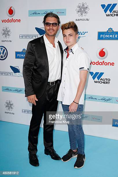 Hardy Krueger jr and his son attend the Helene Fischer Christens 'Mein Schiff 3' on June 12 2014 in Hamburg Germany