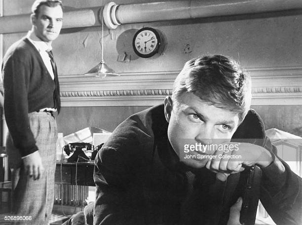Hardy Kruger as painter JanVan Rooyer and Stanley Baker as Inspector Morgan in the 1958 mystery film Blind Date