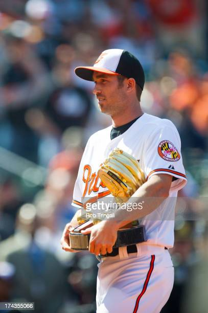 J Hardy of the Baltimore Orioles accepts the Golden Glove Award before the game against the Minnesota Twins at Oriole Park at Camden Yards on April 5...
