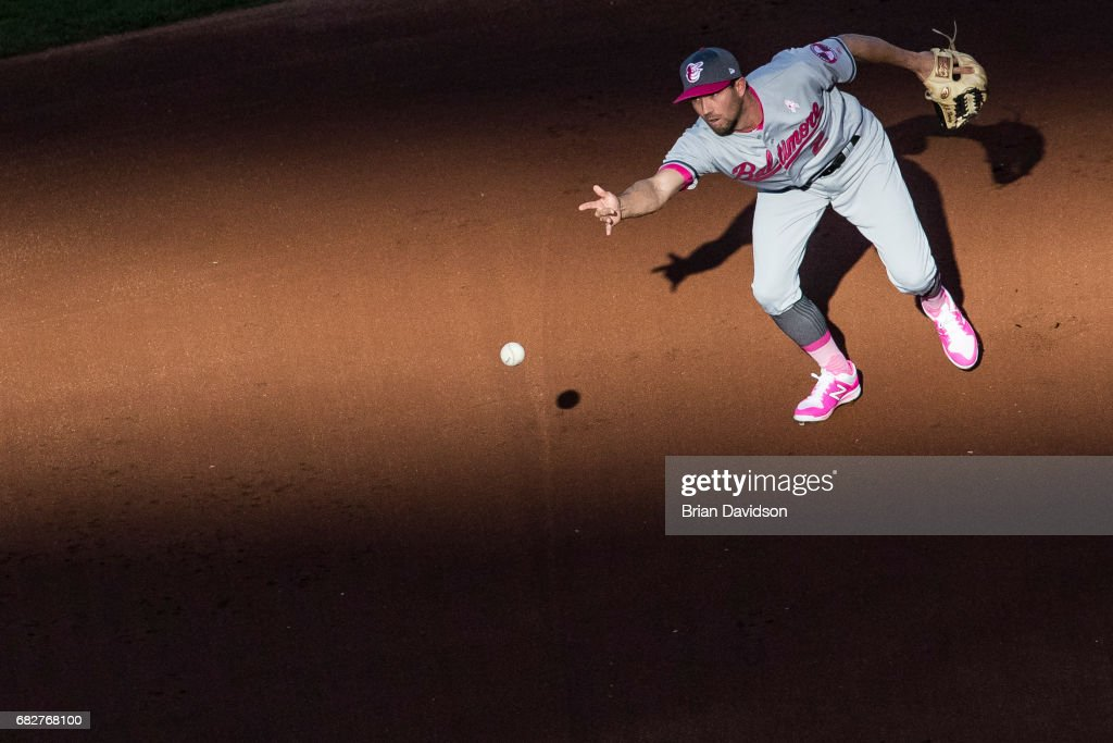 J.J. Hardy #2 of the Baltimore Orioles assists in a double play against the Kansas City Royals during the first inning at Kauffman Stadium on May 13, 2017 in Kansas City, Missouri. Players are wearing pink to celebrate Mother's Day weekend and support breast cancer awareness.