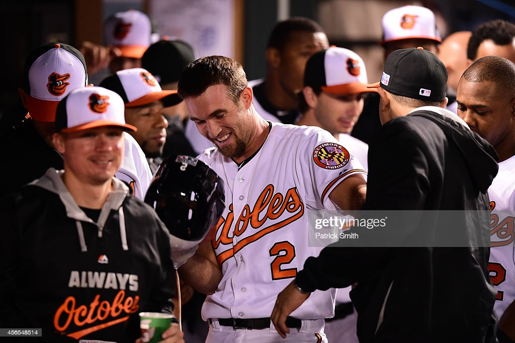 J.J. Hardy #2 of the Baltimore Orioles celebrates with his teammates after hitting a solo home run in the seventh inning against Max Scherzer #37 of the Detroit Tigers during Game One of the American League Division Series at Oriole Park at Camden Yards on October 2, 2014 in Baltimore, Maryland.