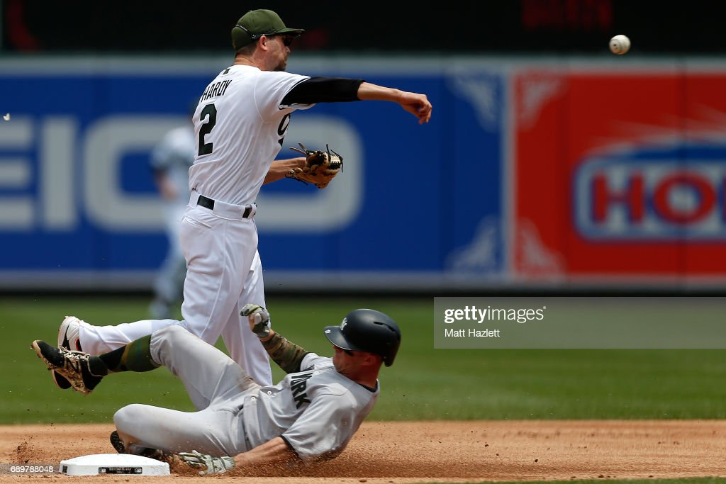 J.J. Hardy #2 of the Baltimore Orioles turns a double play over Brett Gardner #11 of the New York Yankees to get out Matt Holliday #17 of the New York Yankees (not pictured) for the last two outs of the first inning at Oriole Park at Camden Yards on May 29, 2017 in Baltimore, Maryland. MLB players across the league are wearing special uniforms to commemorate Memorial Day.