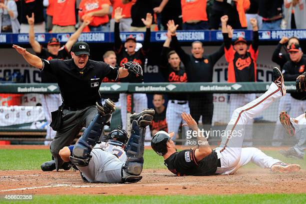 Hardy slides safe to home plate to score on Delmon Young of the Baltimore Orioles three run RBI double to deep left feild in the eighth inning...