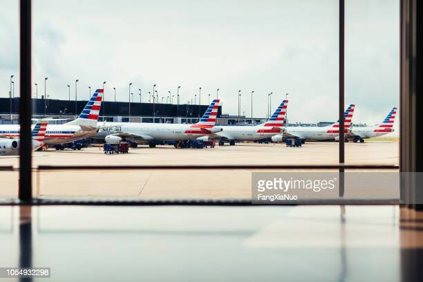o'hare airport with american airlines fleet of airplanes - american airlines stock pictures, royalty-free photos & images