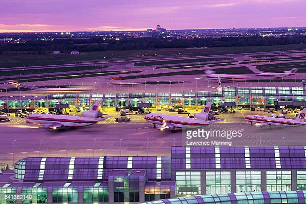 o'hare international airport at dusk - ohare airport stock pictures, royalty-free photos & images