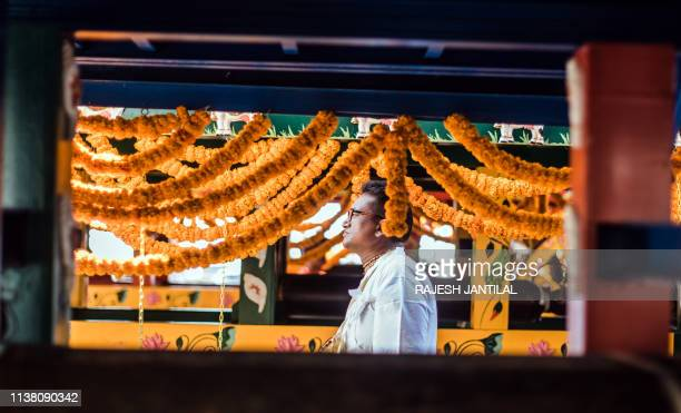 A Hare Krishna devotee stand as devotees from all over South Africa sing and chant through North Beach during the 30th annual Rathayatra in Durban on...