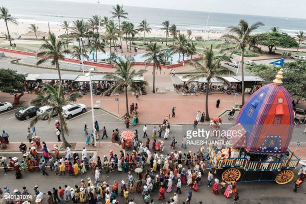 Hare Krishna devotees from all over South Africa sing and chant as they pull a chariot through North Beach in Durban on March 30 during the 29th...