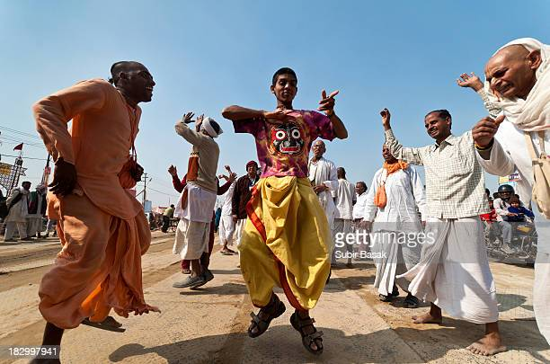 CONTENT] Hare Krishna followers of International Society for Krishna Consciousness dancing in a procession towards Sangam or confluence of the Yamuna...
